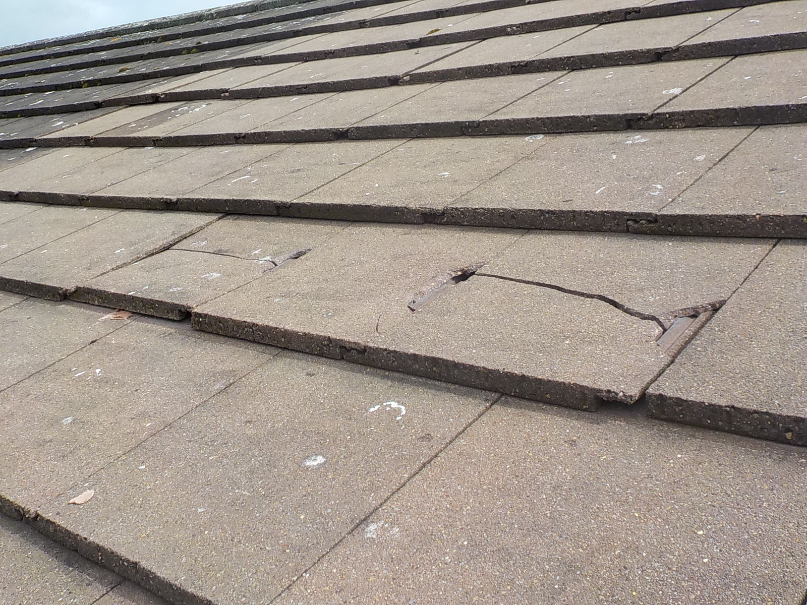 Surveyors report on defective tiles